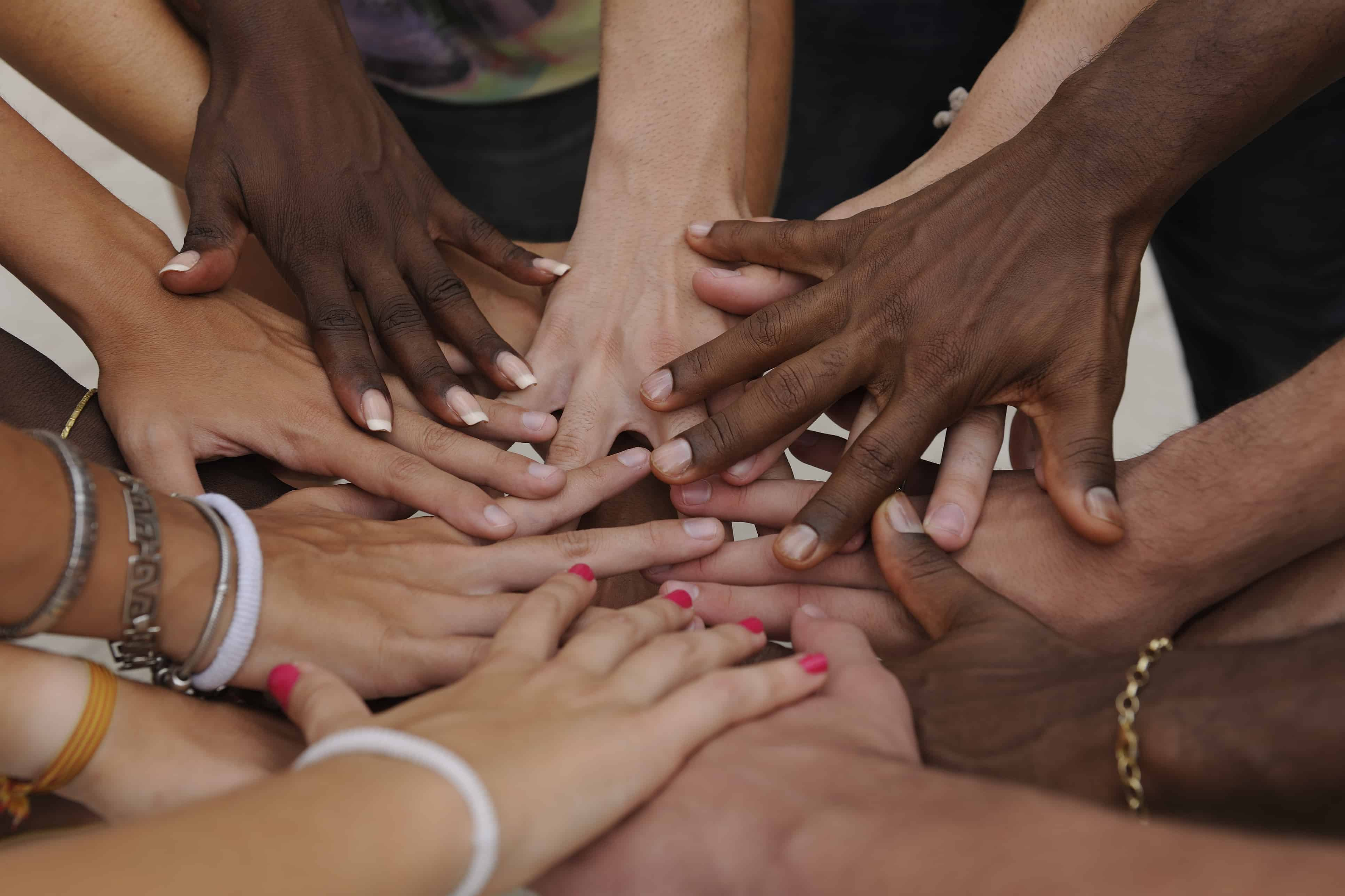 Diverse human hands showing unity